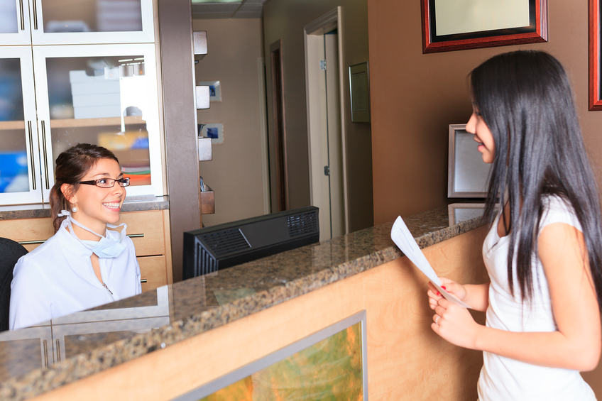Dentist Receptionist With Client